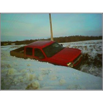 Chevrolet truck stuck in a deep ditch in Elk River MN